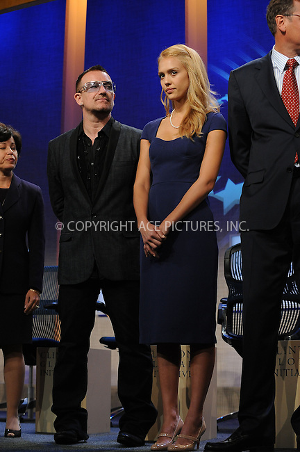 WWW.ACEPIXS.COM . . . . . ....September 24 2009, New York City....Bono of U2 and actress Jessica Alba at the Clinton Global Initiative on September 24 2009 in New York City....Please byline: KRISTIN CALLAHAN - ACEPIXS.COM.. . . . . . ..Ace Pictures, Inc:  ..tel: (212) 243 8787 or (646) 769 0430..e-mail: info@acepixs.com..web: http://www.acepixs.com