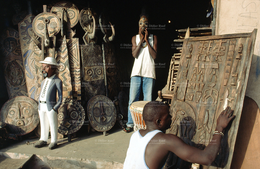 Senegal. Dakar. African art ( mask, statues,figures, animals, shield,.door.) for sale to tourists.  Objects are made out of wood. © 2000 Didier Ruef