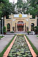 Ornamental pond leading to gates of Buddhist Temple in Cong Vien Van Hoa Park, Ho Chi Minh City (Saigon), Viet Nam.