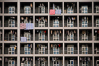 Laundry hangs outside student dormitory windows at the Nanjing University of Science and Technology Zijin College campus in Xianlin district of Nanjing, Jiangsu, China.