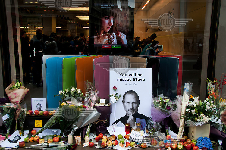 A memorial, outside the Apple store in Regent Street, London, to Steve Jobs, CEO of Apple, who died 5th October 2011.