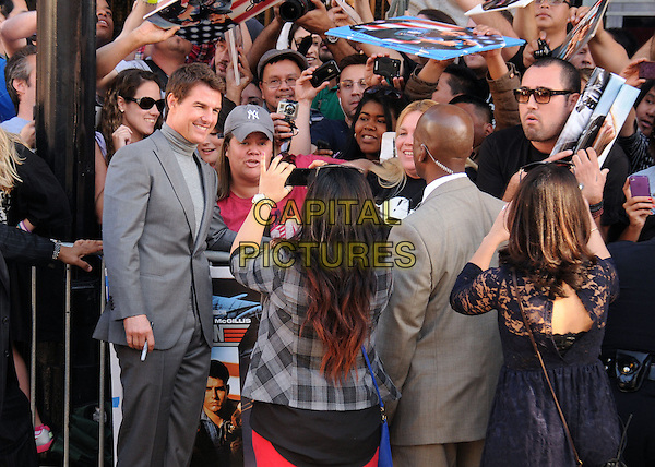 """Tom Cruise.""""Oblivion"""" Los Angeles Premiere held at the Dolby Theatre, Hollywood, California, USA..April 10th, 2013.half length grey gray turtleneck polo neck high collar suit fans crowd signing autographs posing .CAP/ADM/BP.©Byron Purvis/AdMedia/Capital Pictures."""