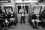 BROOKLYN -- FEBRUARY 14, 2009:  Rapper Aimz rides the A train on his way home to Flatbush on February 14, 2009 in Brooklyn.  (PHOTOGRAPH BY MICHAEL NAGLE)....