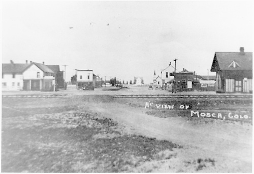 View across D&amp;RG tracks down the main street of Mosca.<br /> D&amp;RG  Mosca, CO