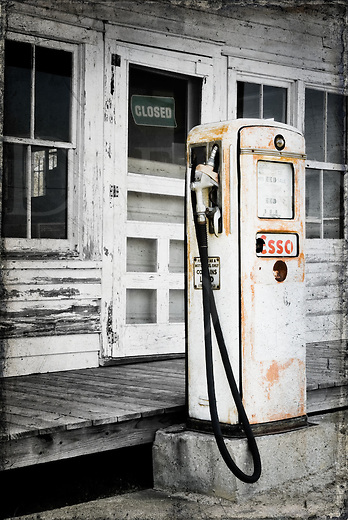 This gas pump was found at a country general store that had been long closed along the main road into the Outer Banks in North Carolina, out of both business and gasoline. Nowadays, it sits with another companion pump selling premium and they have been simply watching the traffic go by on the new road out front for a few decades now. A small interesting tidbit about this dated and obsolete relic is showing on the pump face: sixty-one cents a gallon!<br />
