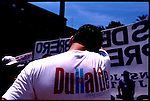 A Duhalde presidential supporter wipes his face at the Plaza de Mayo.