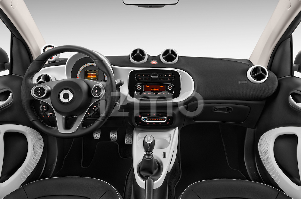 Stock photo of straight dashboard view of 2016 Smart fortwo prime 3 Door Micro Car Dashboard