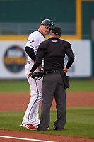 Lansing Lugnuts manager Dallas McPherson (33) discusses a call on the field with home plate umpire Lance Seilhamer during a Midwest League game against the Wisconsin Timber Rattlers at Cooley Law School Stadium on May 1, 2019 in Lansing, Michigan. Wisconsin defeated Lansing 2-1 in the second game of a doubleheader. (Zachary Lucy/Four Seam Images)