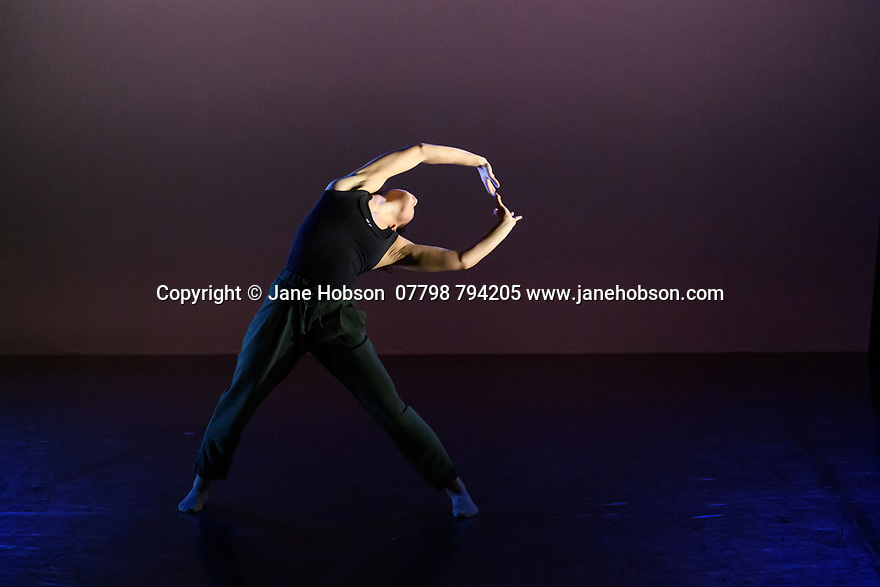 """Leeds, UK. 03.12.2019. Second Year students of BA (Hons) Dance (Contemporary), at the Northern School of Contemporary Dance, present work as part of NEW GROUND, in the Riley Theatre. This piece is: """"Weight Now"""" by choreographer Imogen Wright. Lighting design is by Mark Baker. The dancer is: Imogen Wright. Photograph © Jane Hobson."""