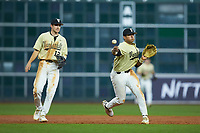 Jayson Gonzalez (99) of the Vanderbilt Commodores makes a throw to first base against the Houston Cougars during game nine of the 2018 Shriners Hospitals for Children College Classic at Minute Maid Park on March 3, 2018 in Houston, Texas. The Commodores defeated the Cougars 9-4. (Brian Westerholt/Four Seam Images)