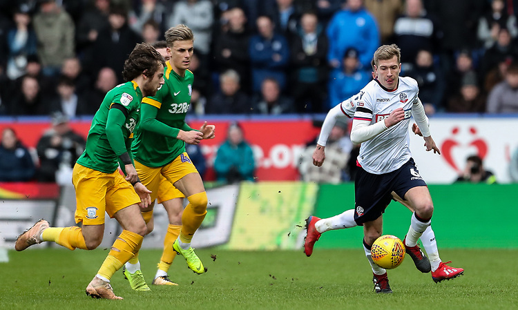 Bolton Wanderers' Josh Vela breaks away from Preston North End's Brad Potts and  Ben Pearson<br /> <br /> Photographer Andrew Kearns/CameraSport<br /> <br /> The EFL Sky Bet Championship - Bolton Wanderers v Preston North End - Saturday 9th February 2019 - University of Bolton Stadium - Bolton<br /> <br /> World Copyright &copy; 2019 CameraSport. All rights reserved. 43 Linden Ave. Countesthorpe. Leicester. England. LE8 5PG - Tel: +44 (0) 116 277 4147 - admin@camerasport.com - www.camerasport.com