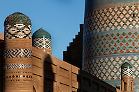 A detail of the Matniyaz Divanbegi madrasah (left), 1871, and Kalta minar (right), 1855, Khiva, Uzbekistan, seen at sunrise on July 6 2010. Their  impressive glazed tile decorations dominate the picture.
