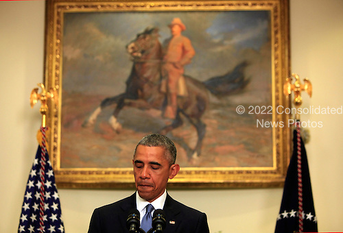 United States President Barack Obama delivers remarks on the completion of a review and to announce a new policy concerning how the US Government responds to overseas hostage situations in the Roosevelt Room of the White House in Washington, DC on June 24, 2015.  <br /> Credit: Dennis Brack / Pool via CNP
