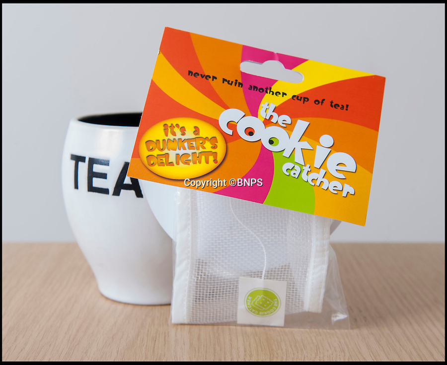 BNPS.co.uk (01202 558833)<br /> Pic: PhilYeomans/BNPS<br /> <br /> Finally...An end to the Tea-break terror...<br /> <br /> Tea drinkers are rejoicing after a nifty device designed to catch crumbs left by dunking biscuits in your brew hit the shelves.<br /> <br /> Dad of two Andrew Tinsley solved the age-old problem with a canny mesh pouch which sits inside a mug of tea collecting any unwanted biscuit bits that might float off during dunking.<br /> <br /> And should your Digestive or Rich Tea become too soggy and break off altogether this cheap and cheerful gadget will guarantee drinkers are not left with a heap of biscuity sludge at the bottom of their cup.<br /> <br /> Entrepreneur Andrew, 49, dreamed up the product, called the Cookie Catcher, after watching family members lose their sodden biscuits in their tea after dunking them for too long during Christmas celebrations last year.