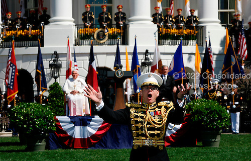 The conductor of the Marine Band directs his orchestra at the Arrival Ceremony hosted by the president and Mrs Bush for Pope Benedict XVI, in the South Lawn of the  White House, Washington DC, April 16, 2008.