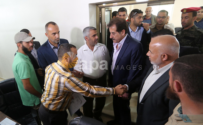 "Chief of General Committee for Crossings and Borders in the Palestinian Authority, Nazmi Mohana visits the passenger registration service headquarter ""Abu Khadra Governmental Complex"" in Gaza city on October 16, 2017. Photo by Mohammed Asad"