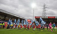 The Teams head onto the field during the Sky Bet League 2 match between Wycombe Wanderers and Luton Town at Adams Park, High Wycombe, England on 6 February 2016. Photo by Andy Rowland.