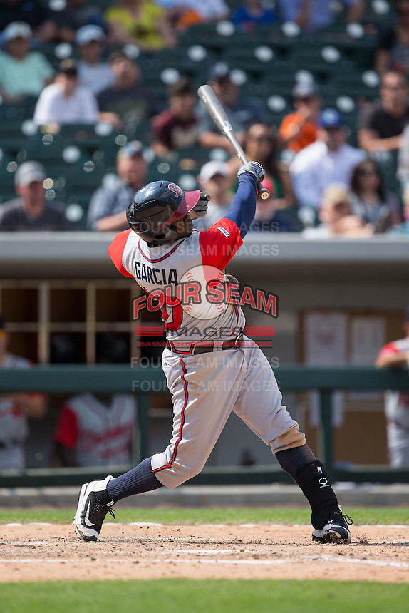 Adonis Garcia (30) of the Gwinnett Braves swings with one hand against the Charlotte Knights at BB&T BallPark on May 22, 2016 in Charlotte, North Carolina.  The Knights defeated the Braves 9-8 in 11 innings.  (Brian Westerholt/Four Seam Images)