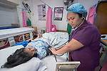 Nurse Raizagar Celazo cares for Cassandra Villarnel in the labor room of the Mary Johnston Hospital in Manila, Philippines. <br /> <br /> The hospital is supported by United Methodist Women.