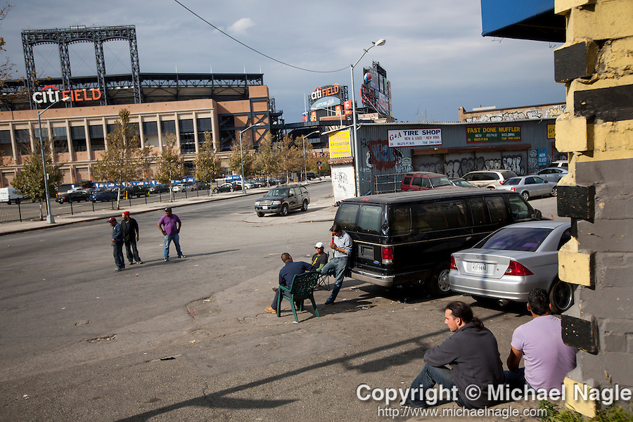 QUEENS, NY -- OCTOBER 22, 2013:  Workers wait for customers in Willets Point on October 22, 2013 in Queens.  Photographer: Michael Nagle for The New York Times