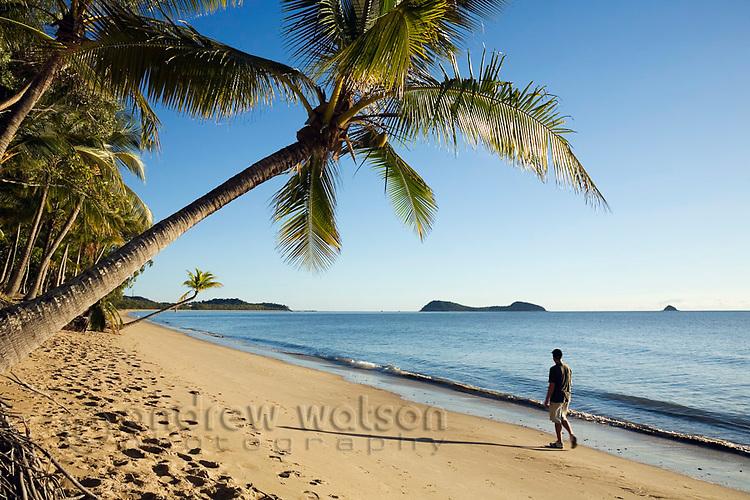 Man walking along beach.  Clifton Beach, Cairns, Queensland, Australia