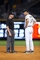 Charlotte Knights manager Joel Skinner (37) discusses a call with third base umpire Jon Byrnes during the game against the Durham Bulls at BB&T BallPark on July 22, 2015 in Charlotte, North Carolina.  The Knights defeated the Bulls 6-4.  (Brian Westerholt/Four Seam Images)