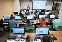 Classroom photo of Music 148, Music Production taught by Daniel Wohl in the Academic Commons oMac Lab, Nov. 8, 2017. Students use the library's computer lab and all the audio equipment to create music.<br /> (Photo by Marc Campos, Occidental College Photographer)