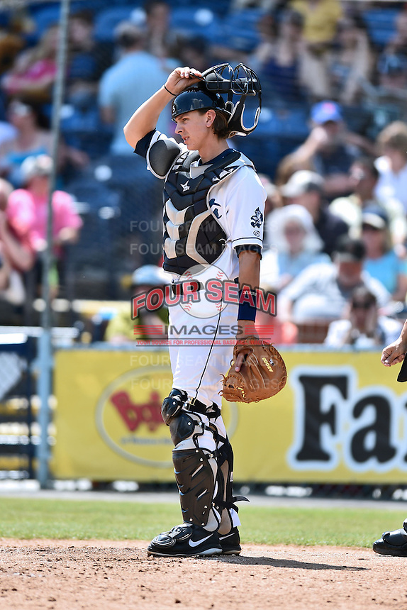 Asheville Tourists catcher Robbie Perkins (5) during a game against the Lexington Legends on May 3, 2015 in Asheville, North Carolina. The Legends defeated the Tourists 6-3. (Tony Farlow/Four Seam Images)