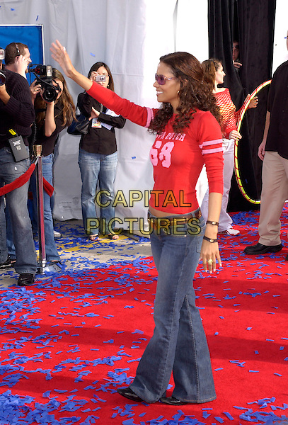 "HALLE BERRY.The Twentieth Century Fox's Los Angeles Premiere of ""Robots"" held at The Mann Village Theatre in Westwood, California .March 6th, 2005.full length waving gesture red top jeans denim profile von dutch.www.capitalpictures.com.sales@capitalpictures.com.Supplied By Capital PIctures"