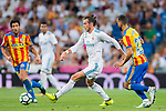 Gareth Bale (l) of Real Madrid is followed by Martin Montoya Torralbo of Valencia CF during their La Liga 2017-18 match between Real Madrid and Valencia CF at the Estadio Santiago Bernabeu on 27 August 2017 in Madrid, Spain. Photo by Diego Gonzalez / Power Sport Images