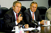 United States President George W. Bush answers a question about Osama bin Laden during a media opportunity held after meeting with US Secretary of Defense Donald H. Rumsfeld and the National Security team at the Pentagon on September 16, 2001. <br /> Mandatory Credit: Cedric H. Rudisill / USAF via CNP