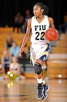 28 January 2012:  FIU guard Jerica Coley (22) handles the ball in the second half as the FIU Golden Panthers defeated the Western Kentucky University Hilltoppers, 60-56, at the U.S. Century Bank Arena in Miami, Florida.  Coley, who has scored the second-most points of any women's player in the country, finished the game with 36 points and surpassed the 1,000 point mark.