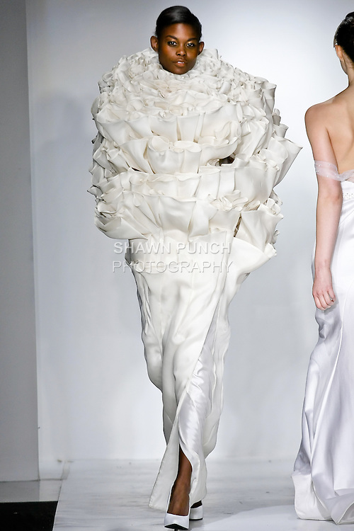 Model walks the runway in a disquistion outfit, designed by Timothy Kuzmeski, during the Pratt Institute 2010 Fashion Show on May 13, 2010.