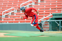 Infielder Yoan Moncada (24) of the Greenville Drive works out before a game against the Lexington Legends on Monday, May 18, 2015, at Fluor Field at the West End in Greenville, South Carolina. Moncada, a 19-year-old prospect from Cuba, made his professional debut today in the Red Sox organization. (Tom Priddy/Four Seam Images)