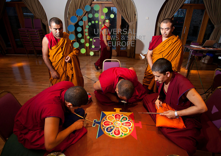 Tibetan monks create an intricate and beautiful picture made from coloured sand at St Mungo Museum of Religious Life and Art,The Mandala will be painstakingly created from millions of grains of sand as part of a Tantric Buddhist ritual, invoking the presence of the Buddha in a design representing the palace of the deities. .Picture: Johnny Mclauchlan News and Sport (Europe)23/11/2011