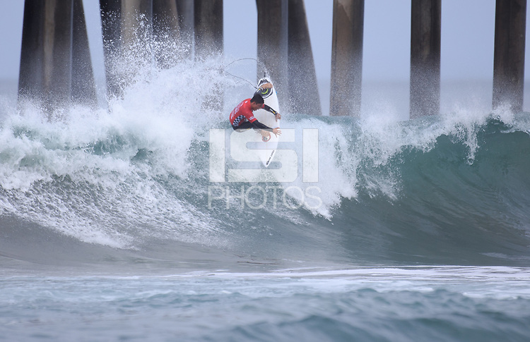 Huntington Beach, CA - Sunday July 30, 2017: Flavio Nakagima during a Qualifying Series (QS) trials round heat in the 2017 Vans US Open of Surfing on the South side of the Huntington Beach pier.