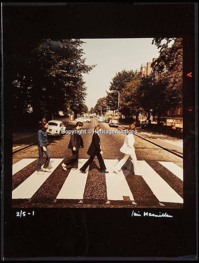 BNPS.co.uk (01202 558833)<br /> Pic: HeritageAuctions/BNPS<br /> <br /> The fully uncropped negatives which are also included.<br /> <br /> A rare set of the iconic images of the Beatles crossing Abbey Road shot for the cover of their world famous album have emerged at auction.<br /> <br /> The complete set of six out-take photos, which were rejected as possible covers, is one of only five sets of prints that were made from the fully uncropped negatives, making it particularly rare.<br /> <br /> The snaps were taken by Scots photographer Iain Macmillan, a close friend of John Lennon, who balanced precariously on a ladder in the middle of the road in north London while a willing policeman held up and directed traffic on the busy Abbey Road on August 8, 1969.<br /> <br /> The pictures have an estimate of £63,000 but experts at Heritage Auctions in New York say they could sell for hundreds of thousands on October 27.