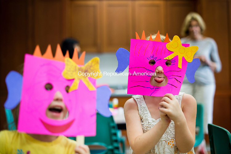 "MIDDLEBURY, CT- 5 August 2015-080515EC01-  Sabrina Pereira, 3, and Kiersten Peyton, 4, display masks they made Wednesday from ""Monsters Love Underpants,"" a new book featured at the Middlebury Library. Every Wednesday the library holds it's Creative Kids program, with crafts and storytelling. Erin Covey Republican-American"