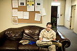 October 14, 2008. Camp LeJeune, North Carolina..  The Wounded Warrior Battalion East, at Camp LeJeune Marine Base in Jacksonville, NC. The battalion was set up to provide a place for wounded Marines to recover as they work through the issues of their injuries and wade through the paperwork involved with possible discharge or reassignment within the Marine Corps.. Cpl. Herbert Jefferson Cooper III works on his paperwork to help figure out what level of disability he will receive from the Department of Defense. Much of the time at the battalion is spent on this paperwork as it differs significantly from the VA medical program and allows for a better check after discharge.