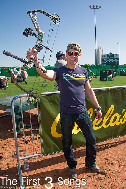 Dustin Lynch attends the ACM & Cabela's Great Outdoor Archery Event during the 50th Academy Of Country Music Awards at the Texas Rangers Youth Ballpark on April 18, 2015 in Arlington, Texas.