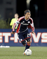 New England Revolution midfielder Lee Nguyen (24) brings the ball forward. Despite a red-card man advantage, in a Major League Soccer (MLS) match, the New England Revolution tied New York Red Bulls, 1-1, at Gillette Stadium on September 22, 2012.