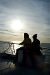 Couple on boat at  Marina Del Rey harbor in Los Angeles