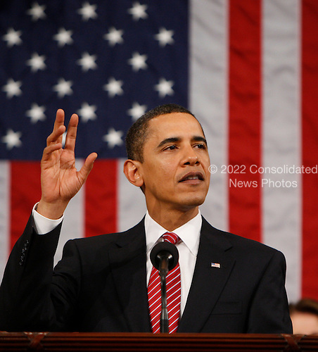Washington, DC - February 24, 2009 -- United States President Barack Obama waves after his address to a joint session of Congress in the House Chamber of the Capitol in Washington , Tuesday, Feb. 24, 2009. .Credit: Pablo Martinez Monsivais - Pool via CNP