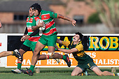 Alamoti Funaki makes a break past Trent White. Counties Manukau Premier Club rugby game between Pukekohe and Waiuku, played at Colin Lawrie Fields, Pukekohe on Saturday April 14th, 2018. Pukekohe won the game 35 - 19 after leading 9 - 7 at halftime.<br /> Pukekohe Mitre 10 Mega -Joshua Baverstock, Sione Fifita 3 tries, Cody White 3 conversions, Cody White 3 penalties.<br /> Waiuku Brian James Contracting - Lemeki Tulele, Nathan Millar, Tevta Halafihi tries,  Christian Walker 2 conversions.<br /> Photo by Richard Spranger