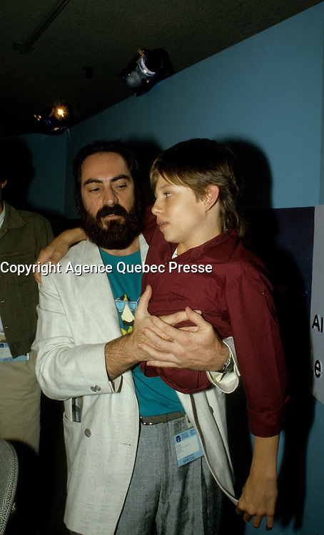 August 28, 1987 File Photo - Montreal (Qc) Canada -Kenny aka the  Kid Brother press conference t at 1987 World Film Festival.<br /> The movie directed by Claude Gagnon won the Grand-Prix des Amerique - Grand Prize of the Americas that year<br /> IN PHOTO : Claude Gagnon, , Kenny Easterday ,