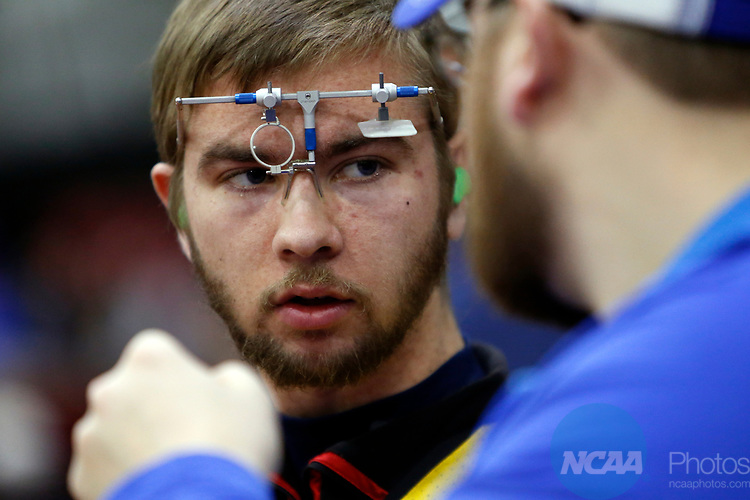 COLUMBUS, OH - MARCH 11:  Robert Scott, of the University of Alaska Fairbanks, talks with a coach during the Division I Rifle Championships held at The French Field House on the Ohio State University campus on March 11, 2017 in Columbus, Ohio. (Photo by Jay LaPrete/NCAA Photos via Getty Images)