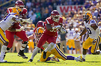 NWA Democrat-Gazette/BEN GOFF @NWABENGOFF<br /> David Williams, Arkansas running back, carries as Zach Rogers, Arkansas center, blocks Christian LaCouture (18), LSU defensive end, in the second quarter Saturday, Nov. 11, 2017 at Tiger Stadium in Baton Rouge, La.