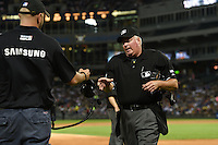 Umpire Time Welke goes to video review during a game between the Toronto Blue Jays and Chicago White Sox on August 15, 2014 at U.S. Cellular Field in Chicago, Illinois.  Chicago defeated Toronto 11-5.  (Mike Janes/Four Seam Images)