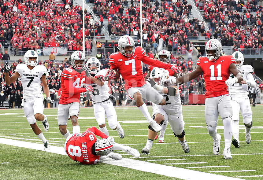 Ohio State Buckeyes safety Damon Webb (7) is forced out of bounds after returning an interception during the fourth quarter of the NCAA football game against the Michigan State Spartans at Ohio Stadium in Columbus on Nov. 11, 2017. [Adam Cairns/Dispatch]