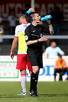 Hot day for Match Officials and players alike as the Assistant Referee enjoys a drink in the middle of a refreshment break during Woking vs Watford, Friendly Match Football at The Laithwaite Community Stadium on 8th July 2017